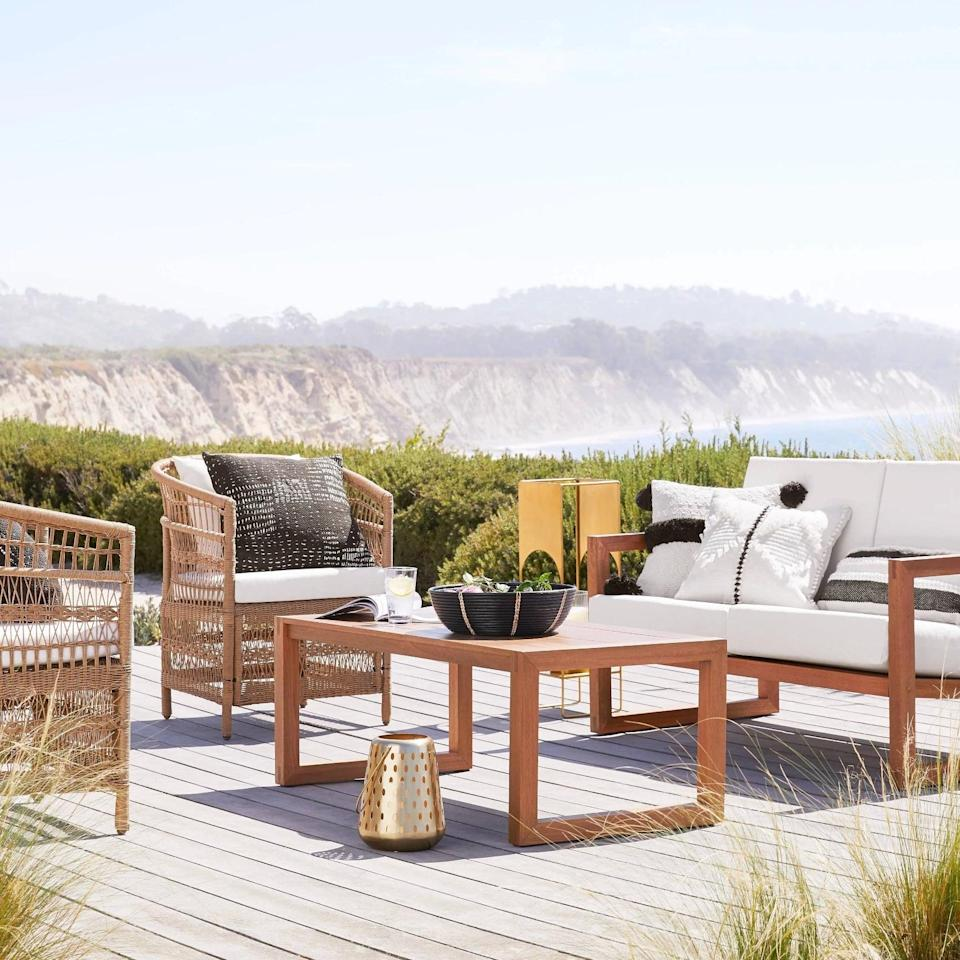 <p>Play games, drink cocktails, and eat tasty appetizers off the <span>Kaufmann Wood Patio Coffee Table</span> ($150).</p>