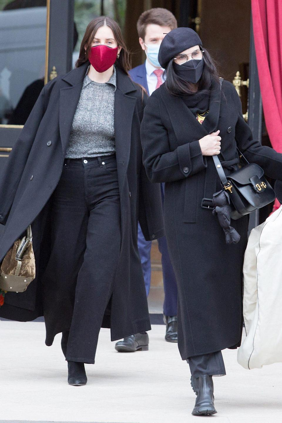 <p>Demi Moore and daughter Scout Willis leave their hotel in Paris on Tuesday during Haute Couture Paris Fashion Week.</p>