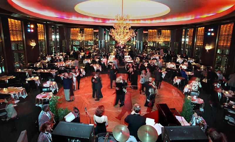 FILE - In this Dec. 17, 1998 file photo, guests at New York's Rainbow Room dance on the revolving floor of the restaurant and nightclub. Closed in 2009 amid a landlord-tenant dispute, the iconic club at Rockefeller Center will reopen in the fall of 2014. Tishman Speyer, which operates Rockefeller Center, made the reopening announcement on Tuesday, Sept. 17, 2013. (AP Photo/Suzanne Plunkett, File)