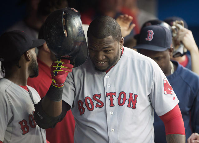 Boston Red Sox's David Ortiz takes off his helmet after hitting a two-run home run in the fourth inning of a baseball game against the Toronto Blue Jays in Toronto on Monday, July 21, 2014. (AP Photo/The Canadian Press, Darren Calabrese)