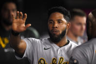 Oakland Athletics' Elvis Andrus celebrates in the dugout after scoring against the Los Angeles Angels during the seventh inning of a baseball game in Anaheim, Calif., Thursday, July 29, 2021. (AP Photo/Kelvin Kuo)