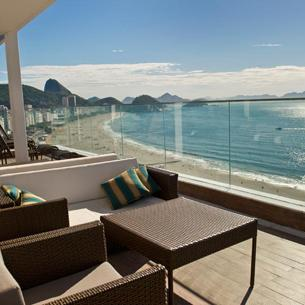 The Copa Cabana Beach from the Pestana Rio hotel - Dance all night and get lucky at street parties and open to sky bars at the vibrant Lapa and Centro areas or in the scores of nightspots around the Copa Cabana beach.