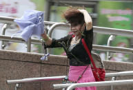 <p>A woman struggles in the wind from Typhoon Nepartak in Taipei, Taiwan, Friday, July 8, 2016. (Chang Hao-an/Central News Agency via AP) </p>