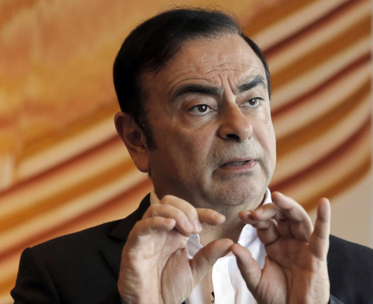 FILE - In this April 20, 2018, file photo, then Nissan Chairman Carlos Ghosn speaks during an interview in Hong Kong. Former Nissan chairman Carlos Ghosn, arrested in Japan on suspicion of underreporting his income, is holding up well while in detention and asked for thriller books, according to the Brazilian consul general, one of the few allowed to visit. (AP Photo/Kin Cheung, File)