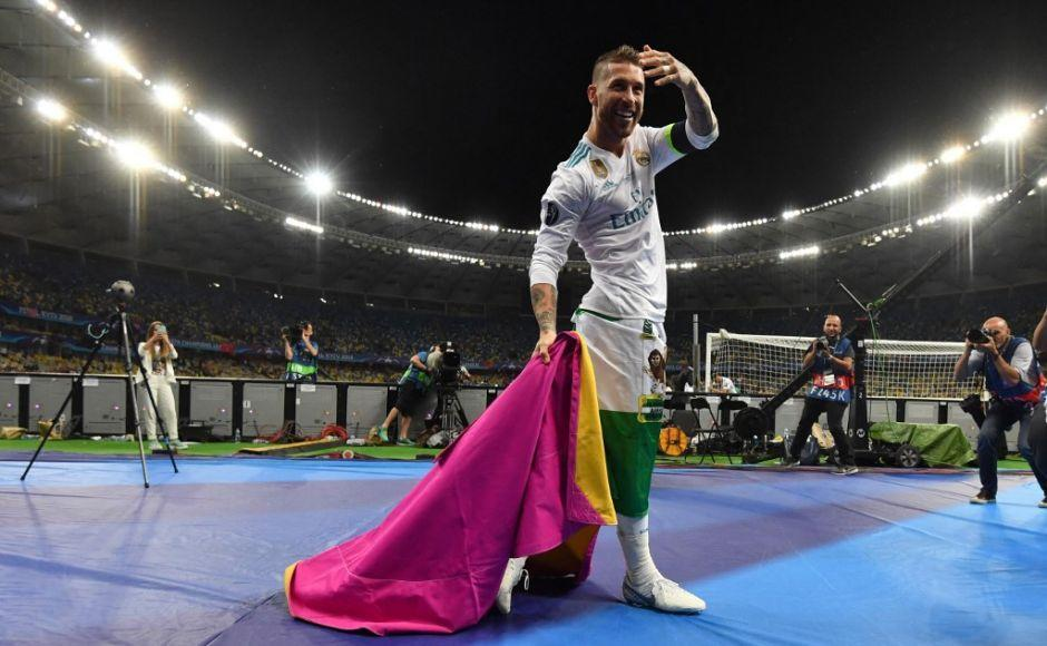 (FILES) In this file photo taken on May 26, 2018 Real Madrid's Spanish defender Sergio Ramos celebrates after winning the UEFA Champions League final football match between Liverpool and Real Madrid at the Olympic Stadium in Kiev, Ukraine. - Legendary captain Sergio Ramos is to leave Real Madrid after a glittering, trophy-laden career spanning 671 games and 16 seasons, the club announced on June 16, 2021. (Photo by GENYA SAVILOV / AFP)