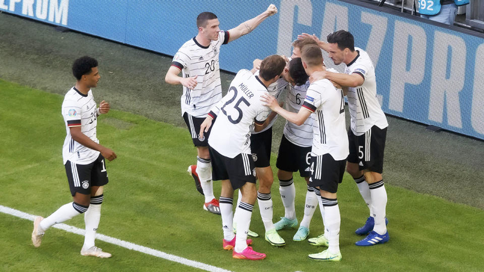 German players, pictured here celebrating after their second goal against Portugal.