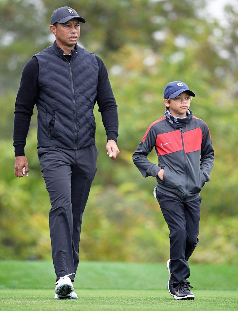 "<p>Tiger Woods and son Charlie hit the links in Orlando on Thursday during a practice round for the Father-Son Challenge golf tournament, which the <a href=""https://people.com/sports/tiger-woods-son-charlie-father-son-caddie-pnc-championship/"" rel=""nofollow noopener"" target=""_blank"" data-ylk=""slk:two will participate in"" class=""link rapid-noclick-resp"">two will participate in</a> (with father-son caddies!) this weekend. </p>"