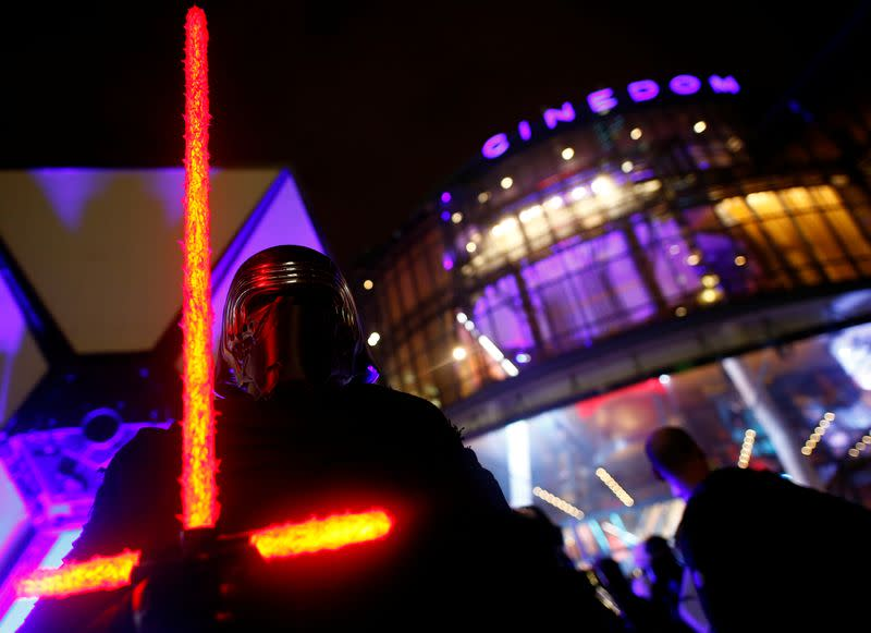 """FILE PHOTO: A fan poses as he awaits a gala screening of """"Star Wars: The Rise of Skywalker"""" film in Cologne"""