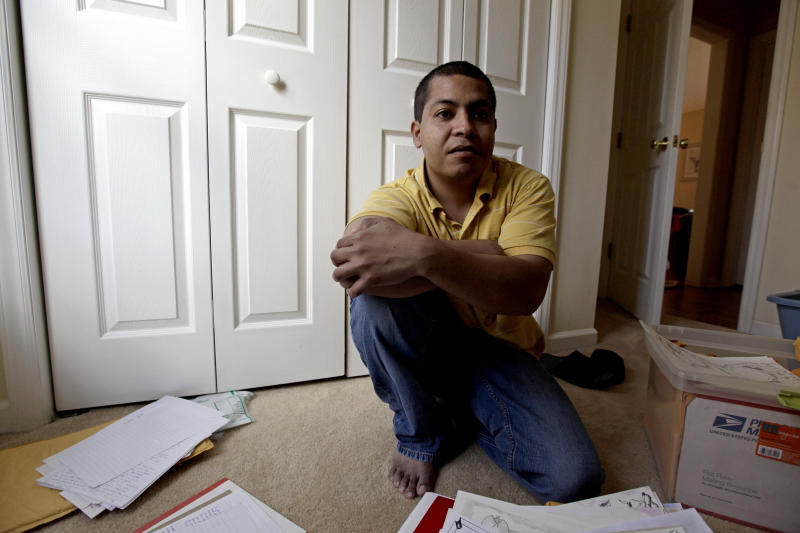 In a photo made Friday, Jan. 27, 2012 photo, Pedro Guzman is shown at home in Durham, N.C. U.S. Immigration and Customs Enforcement detained the Guatemalan native in 2009, and he spent 19 months in private prisons run by CCA in Gainesville and Lumpkin, Georgia. Guzman was released and granted legal permanent residency in May, when ICE's Board of Immigration Appeals overturned his deportation order. (AP Photo/Gerry Broome)