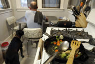 Part of Christian Hainds' carb-free meal remains on a cooking pan as he eats his dinner at his home in Hammond, Ind., Monday, June 7, 2021. Health officials have warned since early on in the pandemic that obesity and related conditions such as diabetes were risk factors for severe COVID-19. It wasn't until he was diagnosed as diabetic around the start of the pandemic that he felt the urgency to make changes. Hainds lost about 50 pounds during the pandemic, and at 180 pounds and 5 feet, 11 inches tall is no longer considered obese. (AP Photo/Shafkat Anowar)