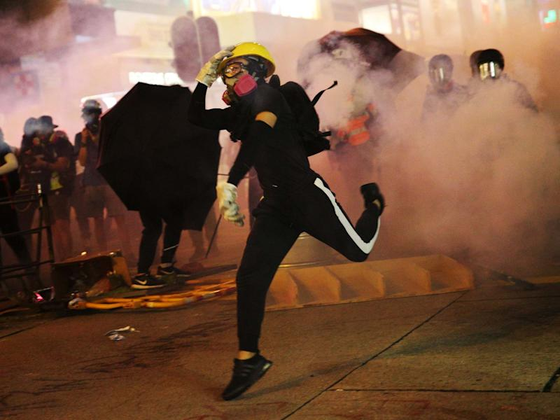 Police officers fired tear gas at protesters during the rally: EPA