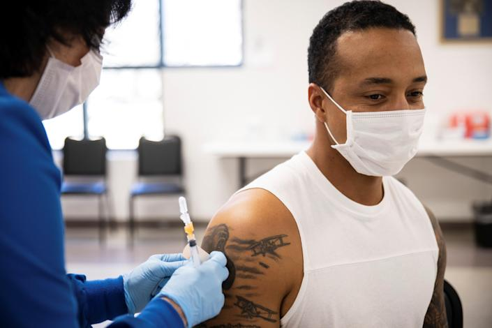 Dashon Bates, 28, receives his coronavirus disease (COVID-19) vaccine as vaccine eligibility expands to anyone over the age of 16 at the Bradfield Community Center through Health Partners of Western Ohio in Lima, Ohio (REUTERS)