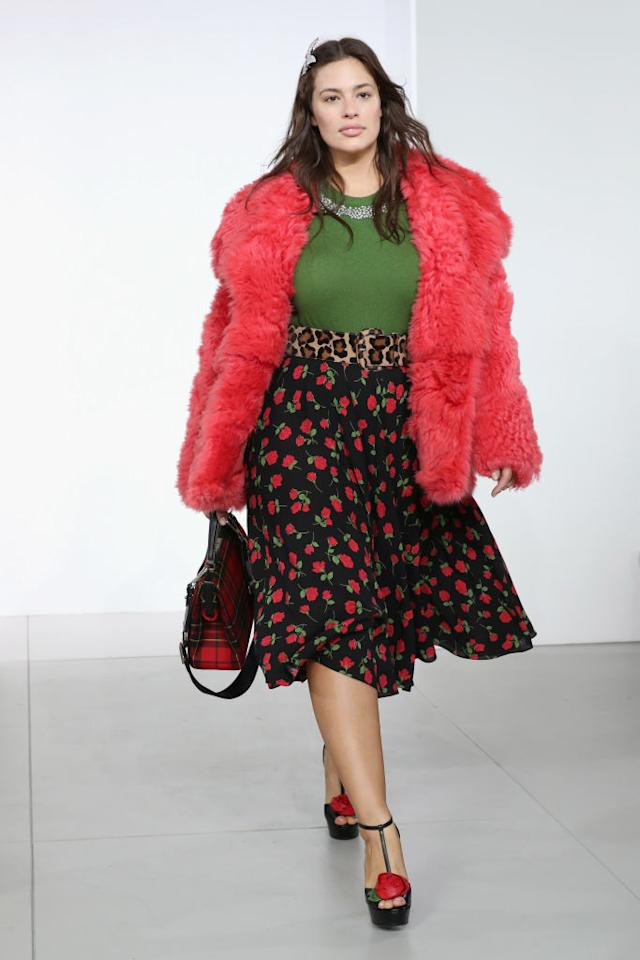<p>Graham walked the Michael Kors runway on Valentine's Day, wearing a skirt that appropriately featured red roses. (Photo: Getty Images) </p>