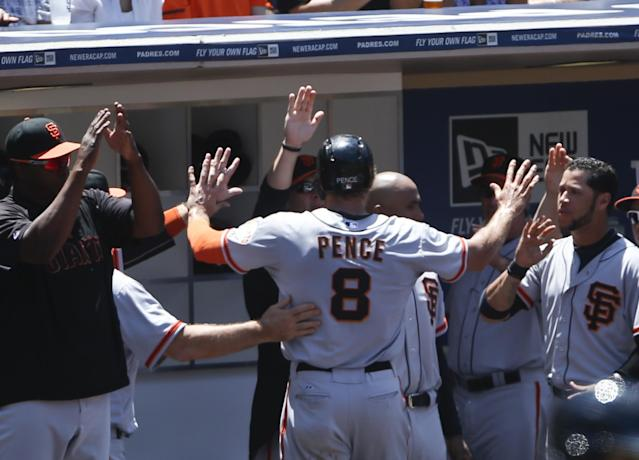 San Francisco Giants' Hunter Pence is greeted at the dugout after scoring in the third inning against the San Diego Padres in a baseball game Sunday, July 6, 2014, in San Diego. (AP Photo/Lenny Ignelzi)