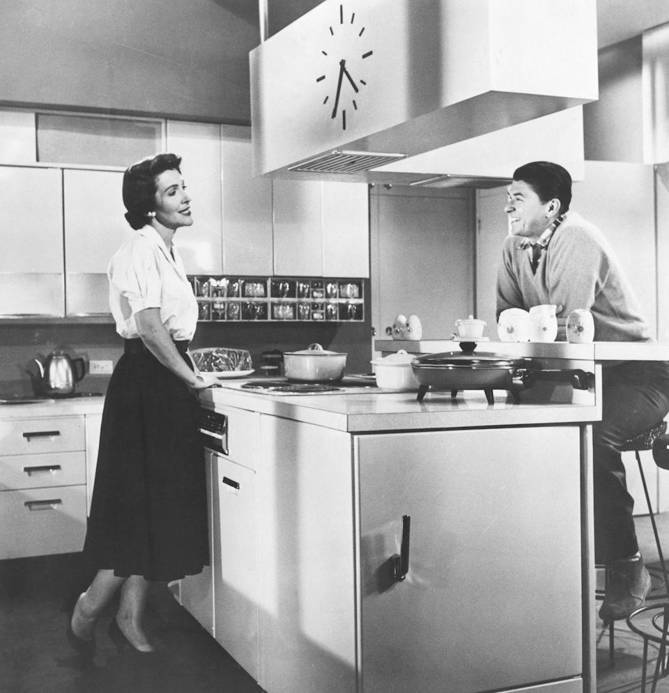 <p>In one of their first photographs together, then-actors Ronald Reagan and Nancy Davis were captured in a kitchen together. </p>