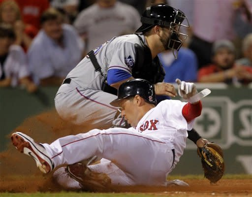 Boston Red Sox's Jacoby Ellsbury, front, scores on a double hit by Carl Crawford as Texas Rangers catcher Mike Napoli, rear, waits for the ball in the eighth inning of a baseball game at Fenway Park in Boston, Monday, Aug. 6, 2012. (AP Photo/Steven Senne)