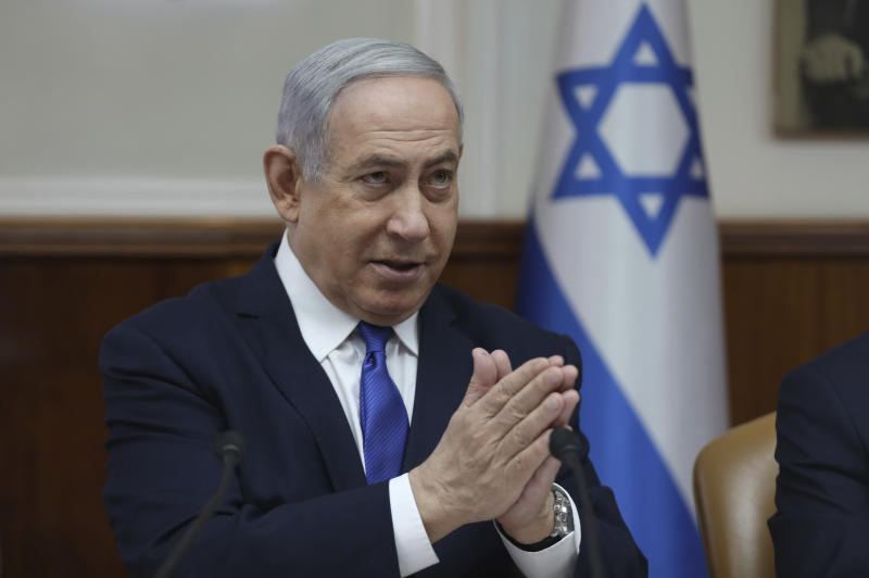 File - In this Sunday, Dec. 29, 2019 file photo, Israeli Prime Minister Benjamin Netanyahu attends the weekly cabinet meeting at his office in Jerusalem. Netanyahu said Monday that he would seek immunity from corruption charges, likely delaying any trial until after March elections, when he hopes to have a majority coalition that will shield him from prosecution. (Abir Sultan /Pool photo via AP, File)