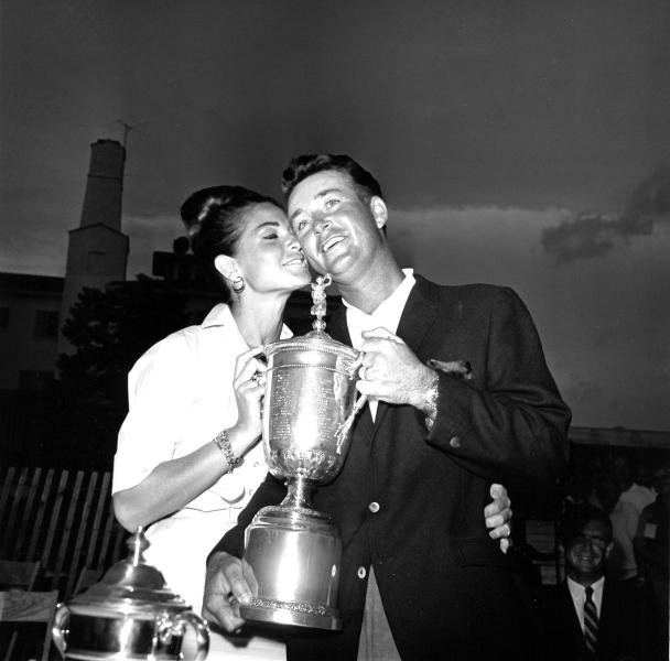 File-This June 20, 1964 file photo shows golfer Ken Venturi getting a kiss from his wife Conni as he accepts the title holder's silver cup of the U.S. Open golf tournament, after a searing final round on the Congressional Country Club course at Bethesda, Md. The former U.S. Open champion has died just 12 days after he was inducted into the World Golf Hall of Fame. He was 82. His son, Matt Venturi, says he died Friday May 17, 2013 in a hospital in Rancho Mirage, Calif. Venturi had been hospitalized the last two months for a spinal infection, pneumonia and an intestinal infection. (AP Photo/File)