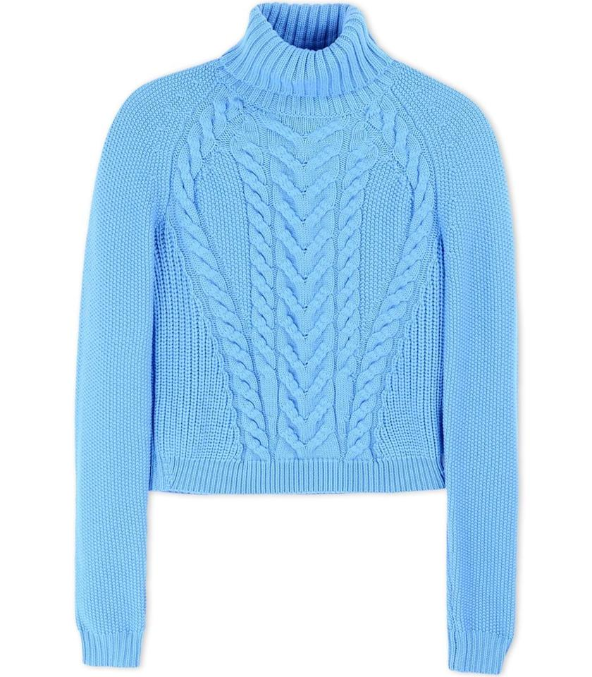 """<p><a href=""""https://shop.harpersbazaar.com/designers/c/carven/blue-cable-turtleneck-sweater-5832.html"""">Carven's</a> blue cable-knit sweater gives us Corey vibes for days — and you don't have to worry about your abs while you wear it.</p>"""