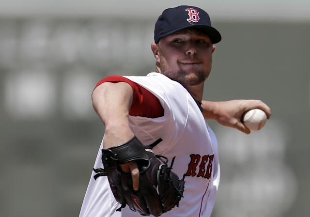 Boston Red Sox's Jon Lester winds up for a pitch against the Tampa Bay Rays in the first inning of a baseball game on Sunday, June 1, 2014, in Boston. (AP Photo/Steven Senne)