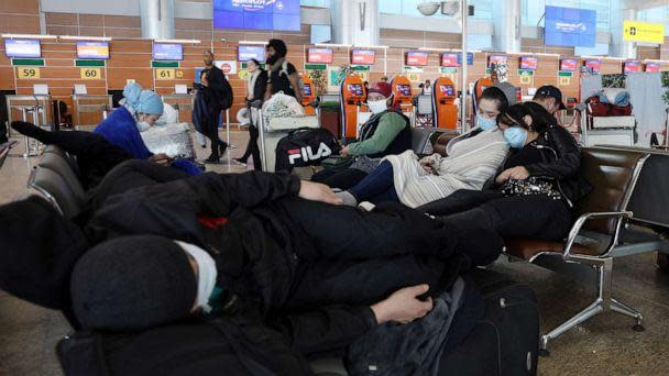 PHOTO: Passengers at Sheremetyevo International Airport sit on the first day of an international flight ban ordered by the government amid the ongoing COVID-19 pandemic and effective since March 27. (Marina Lystseva/TASS/Newscom)