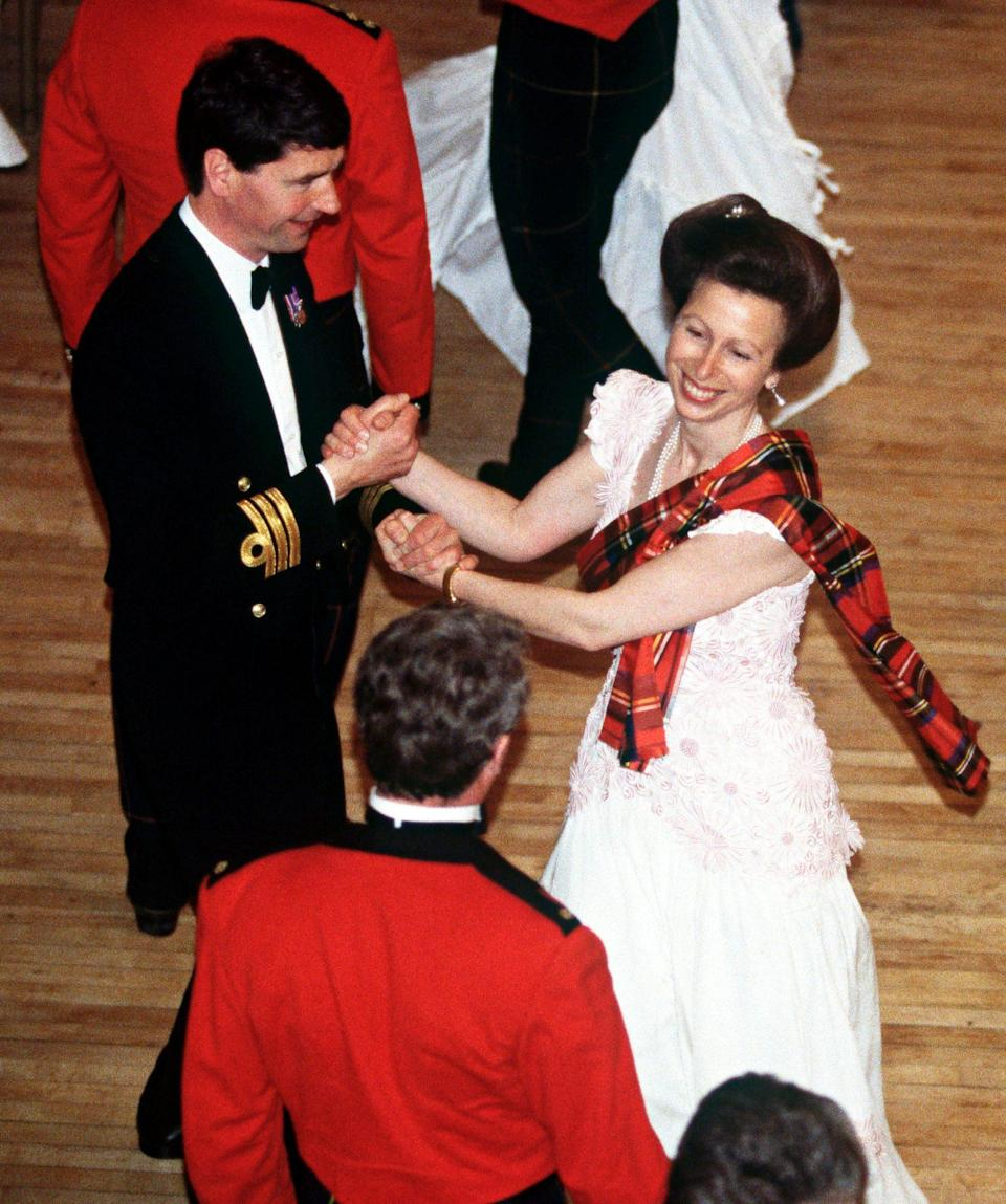 <p>Before the Princess Royal married Timothy Laurence, Anne donned tartan and cut a rug in London with her naval-commander fiancé at the 1992 Royal Caledonian Ball, an annual event benefiting Scottish charities that's considered the oldest charity ball in the world.</p>