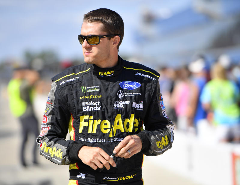 BROOKLYN, MICHIGAN - AUGUST 09: David Ragan, driver of the #38 MDS Transport Ford, walks to his car during qualifying for the Monster Energy NASCAR Cup Series Consumers Energy 400 at Michigan International Speedway on August 09, 2019 in Brooklyn, Michigan. (Photo by Quinn Harris/Getty Images)