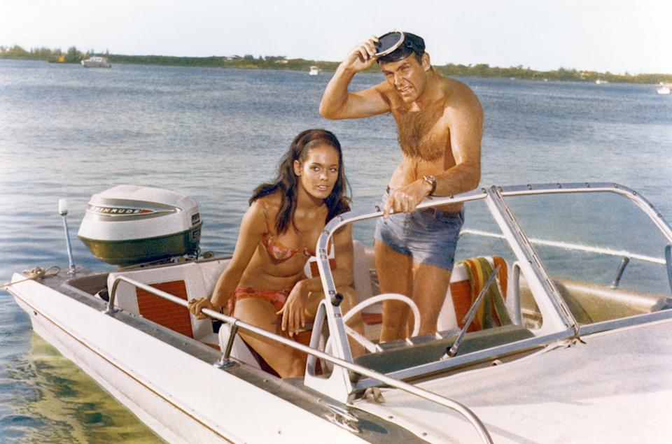 Actor Sean Connery and actress Martine Beswick on the set of