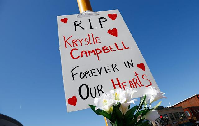 MEDFORD, MA - APRIL 17: Flowers and a sign are left on a street post in Medford Square in remembrance of Krystle Campbell, 29, of Medford, Massachusetts, who was killed by the bomb explosions at the Boston Marathon on April 17, 2013 in Medford, Massachusetts. The explosions, which occurred near the finish line of the 116-year-old Boston race on April 15, resulted in the deaths of three people with more than 170 others injured. (Photo by Jared Wickerham/Getty Images)