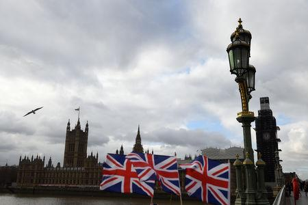 Union Jack flags are seen for sale outside the Houses of Parliament in London