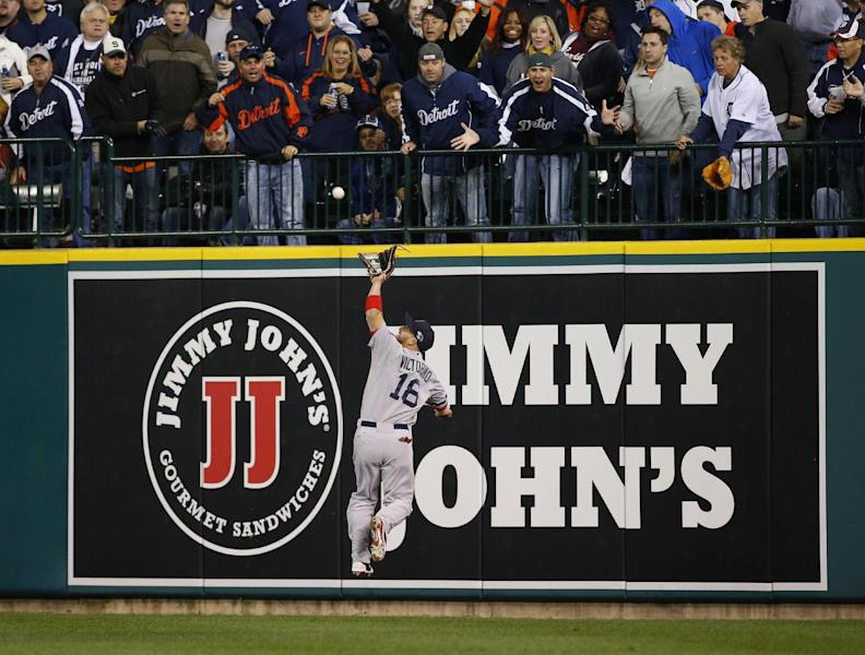 Boston Red Sox right fielder Shane Victorino makes a catch on a Detroit Tigers' Miguel Cabrera fly ball in the seventh inning during Game 4 of the American League baseball championship series Wednesday, Oct. 16, 2013, in Detroit. (AP Photo/Paul Sancya)