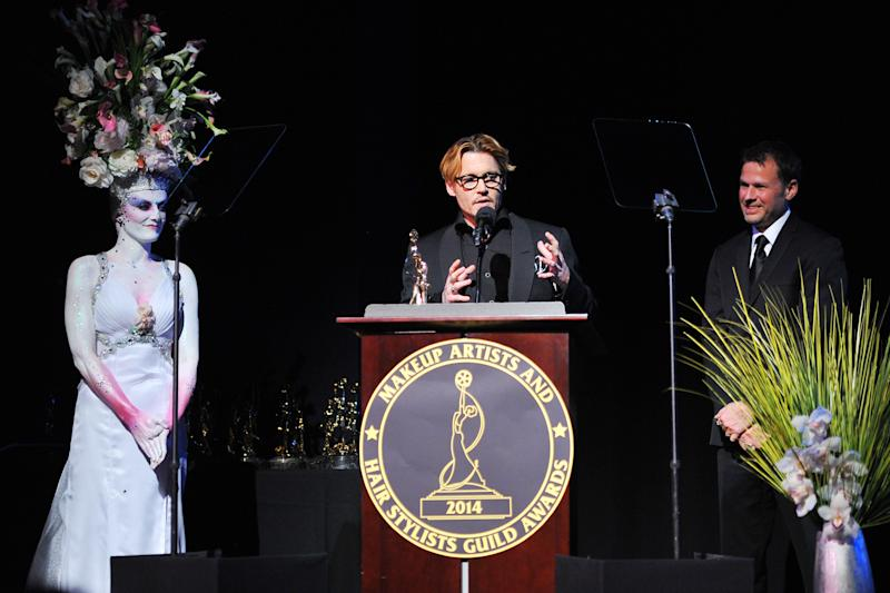 Actor Johnny Depp (C) speaks after accepting the Distinguished Artisan Award at The Make-Up Artists and Hair Stylists Guild Awards on Saturday, Feb. 15, 2014 at Paramount Studios in Los Angeles, California. Make-up artist Joel Harlow(R) presented the award. (Photo by Vince Bucci/Invision/AP)