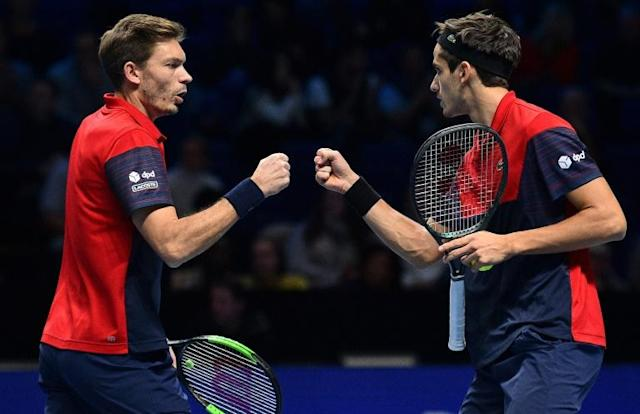 French pair Pierre-Hugues Herbert (right) and Nicolas Mahut won the doubles title at the 2019 ATP Finals (AFP Photo/Glyn KIRK )