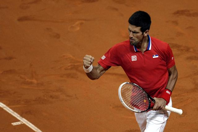 Serbia's Novak Djokovic clinches his fist as he celebrates a point won against Canada's Vasek Pospisil during their Davis Cup semifinals tennis match in Belgrade, Serbia, Friday, Sept. 13, 2013. (AP Photo/Marko Drobnjakovic)