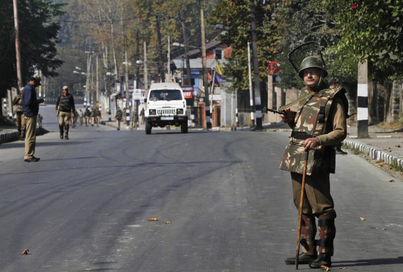 Indian paramilitary soldiers stand guard on a road leading towards the office of United Nations Military Observer Group in India and Pakistan (UNMOGIP) in Srinagar, India, Wednesday, Oct. 27, 2010. Authorities imposed a curfew in many parts of Indian-controlled Kashmir Wednesday to stop pro-independence rallies called by separatists in the disputed Himalayan region. Since June, Kashmir has been rocked by violent anti-India protests and the subsequent crackdowns by government forces that have killed several people.(AP Photo/Dar Yasin)