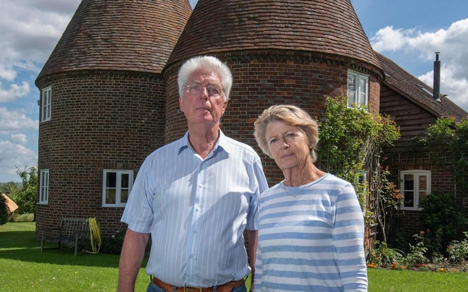 """Mr Pattenden, pictured with his wife Angela outside their home, said: """"We are not NIMBYist and are more than happy to have housing here."""" But he believes there are better-suited brownfield sites - Julian Simmonds"""