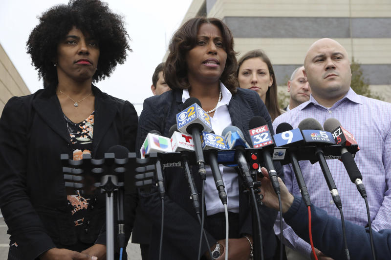 """CPS Chief Education Officer LaTanya McDade, center, with members of the Chicago Public Schools negotiating team, speaks to reporters outside Malcolm X College, Tuesday, Oct. 29, 2019 in Chicago. Representatives for striking Chicago teachers expressed hope following late-night bargaining talks and says the Chicago Teachers Union """"has laid out a path for a settlement"""" that could reopen classrooms in the nation's third-largest school district.  (Antonio Perez/Chicago Tribune via AP)"""