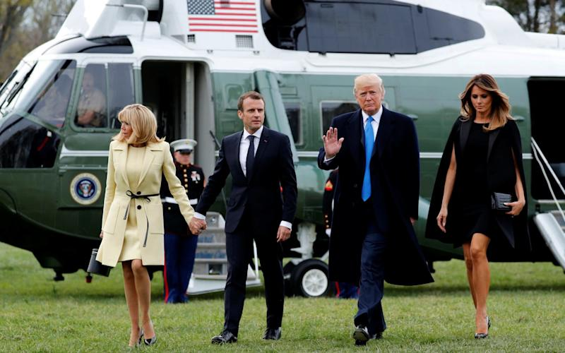 Donald Trump and first lady Melania Trump escort Emmanuel Macron and Brigitte Macron as they arrive together on the Marine One helicopter on a visit to the estate of the first U.S. President George Washington in Mount Vernon - REUTERS