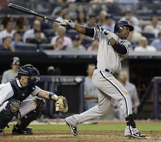 Chicago White Sox's Alejandro De Aza, right, watches his fifth-inning solo home run off New York Yankees starting pitcher Ivan Nova during their baseball game at Yankee Stadium in New York, Thursday, June 28, 2012. (AP Photo/Kathy Willens)