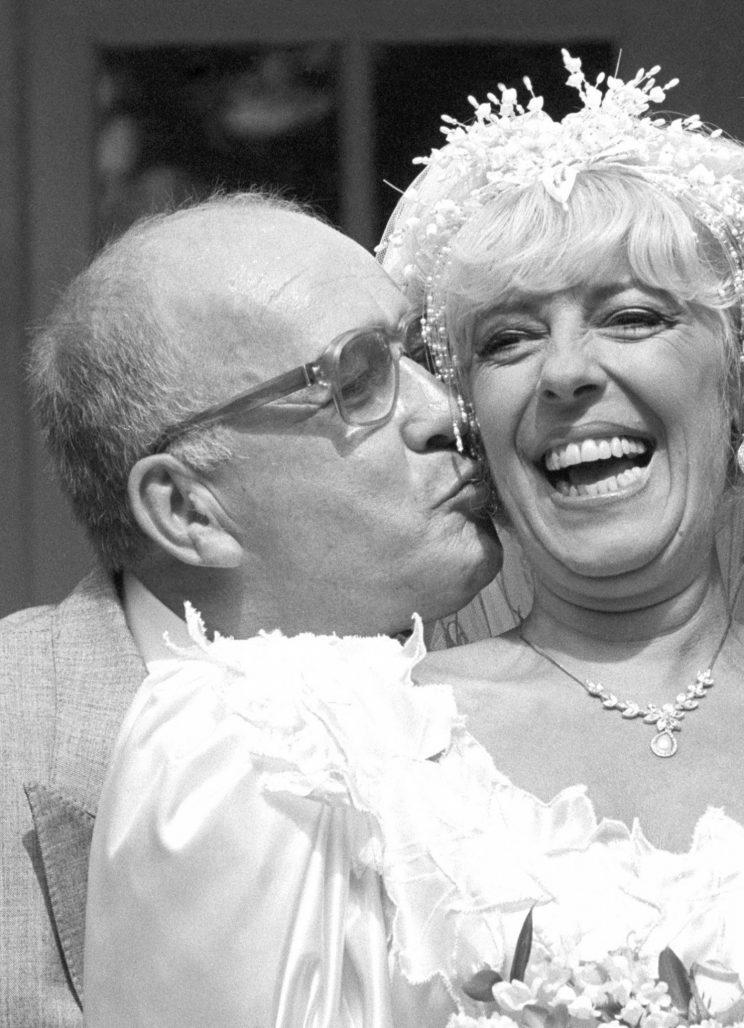 Alec and Bet share a kiss on their wedding day in 1987