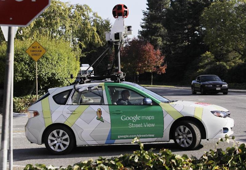 """FILE - In this Oct. 27, 2010 file photo, an employee drives a Google Maps Street View vehicle around Palo Alto, Calif. Internet giant Google's Street View project has raised privacy concerns in several countries. Attorneys suing Google for enabling its camera-carrying vehicles to collect emails and Internet passwords while photographing neighborhoods for the search giant's popular """"Street View"""" maps look forward to resuming their case now that a U.S. appeals court has ruled in their favor. The U.S. Court of Appeals in San Francisco said Tuesday that Google went far beyond listening to accessible radio communication when they drew information from inside people's homes. (AP Photo/Paul Sakuma, File)"""