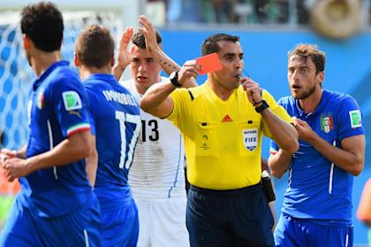 Referee Marco Rodriguez shows a red card to Claudio Marchisio of Italy. (Getty)