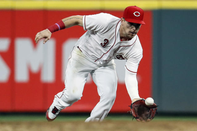 Cincinnati Reds second baseman Scooter Gennett fields a ground ball from Los Angeles Dodgers' Alex Verdugo in the eighth inning of a baseball game, Monday, Sept. 10, 2018, in Cincinnati. Verdugo was thrown out at first. (AP Photo/John Minchillo)