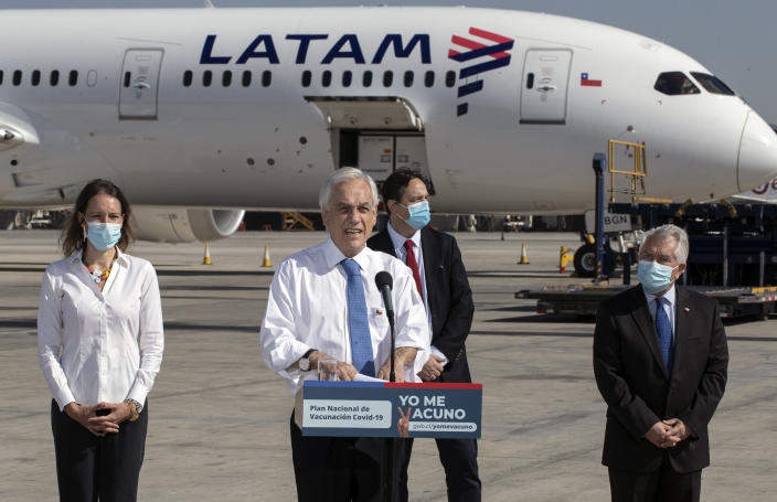 """FILE - In this Thursday, Jan. 28, 2021 file photo, President Sebastian Pinera speaks in front of the plane carrying the country's first batch of the CoronaVac vaccine for COVID-19 developed by Chinese biopharmaceutical company Sinovac Biotech, at Arturo Merino airport in Santiago, Chile. """"Today,"""" he said, """"is a day of joy, emotion and hope."""" (AP Photo/Esteban Felix)"""