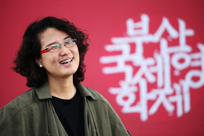 In this Oct. 4, 2013 photo, South Korean Director Kim Lyang poses during an interview with the Associated Press at Busan Cinema Center in Busan, South Korea. Kim, a South Korean based in France, said her first documentary feature was a chance for her to tell stories as a second generation of a divided family. Her father was born in North Korea, and she grew up without knowing any extended family on his side. (AP Photo/Woohae Cho)