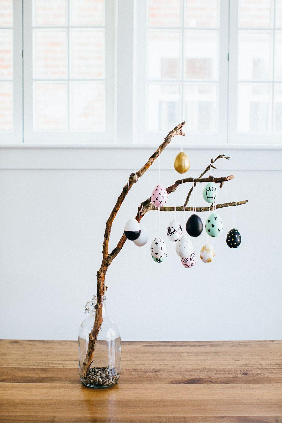 """<p> Hand-drawn motifs and a cohesive, on-trend color palette go a long way in crafting an Instagram-worthy tree. </p><p><strong>Get the tutorial at <a href=""""https://walkinlove.com/blogs/walk-in-love/easter-egg-tree"""" rel=""""nofollow noopener"""" target=""""_blank"""" data-ylk=""""slk:Walk in Love"""" class=""""link rapid-noclick-resp"""">Walk in Love</a>.</strong></p><p><strong><a class=""""link rapid-noclick-resp"""" href=""""https://www.amazon.com/Sharpie-Oil-Based-Paint-Marker-Medium/dp/B00WL2NM0K?tag=syn-yahoo-20&ascsubtag=%5Bartid%7C10050.g.26498744%5Bsrc%7Cyahoo-us"""" rel=""""nofollow noopener"""" target=""""_blank"""" data-ylk=""""slk:SHOP PAINT MARKERS"""">SHOP PAINT MARKERS</a></strong><strong><br></strong></p>"""