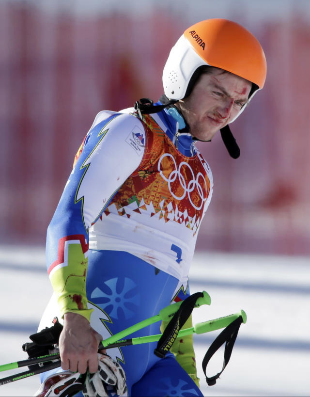 Slovenia's Rok Perko arrives in the finish area after crashing during a men's downhill training run for the Sochi 2014 Winter Olympics, Saturday, Feb. 8, 2014, in Krasnaya Polyana, Russia. (AP Photo/Gero Breloer)