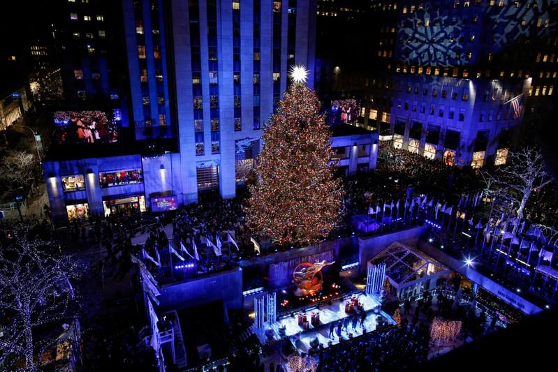 FILE PHOTO: People watch the Christmas tree lighting at Rockefeller Center in the Manhattan borough of New York