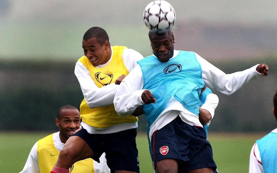Arsenal's William Gallas (right) wins the header against team-mate Gilberto Silva during a training session at London Colney, Hertfordshire in 2006 - Nick Potts/PA