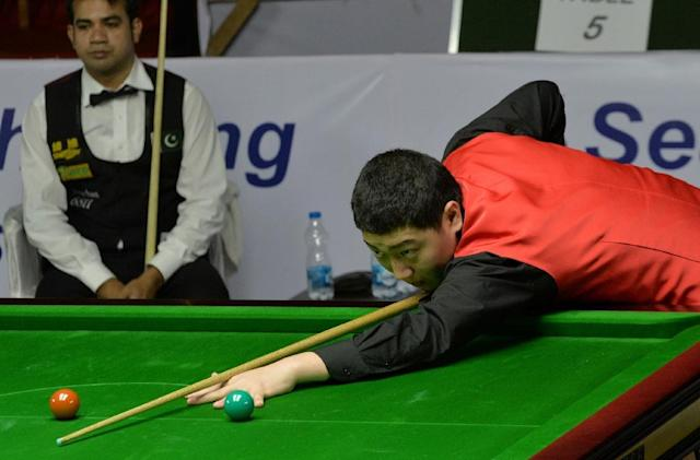 Yan Bingtao, pictured in 2014, threatened at one point to become the youngest player to win a match at the championships at the Crucible Theatre (AFP Photo/Manjunath Kiran)